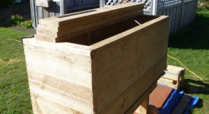 Stack of fence plaings and wooden garden box
